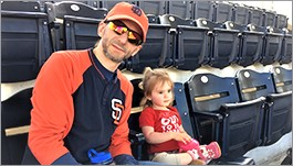 Brent with daughter at ballpark