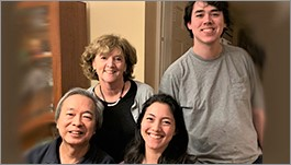 Chi Ho with wife and children