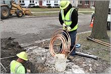 Utility crew replacing lead service line