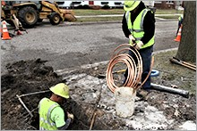 utility crew replacing lead service line
